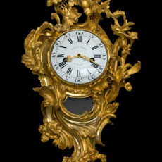 A Louis XV ormolu cartel clock.
