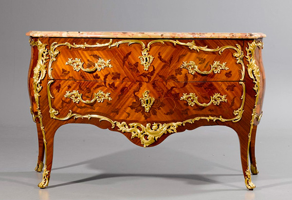 A Louis XV omolu‐mounted bois statiné kingwood and bois de bout marquetry commode