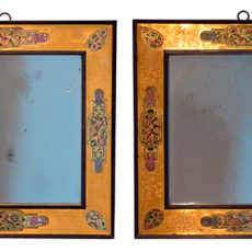 A pair of Italian ebony, giltwood and eglomise square mirrors.