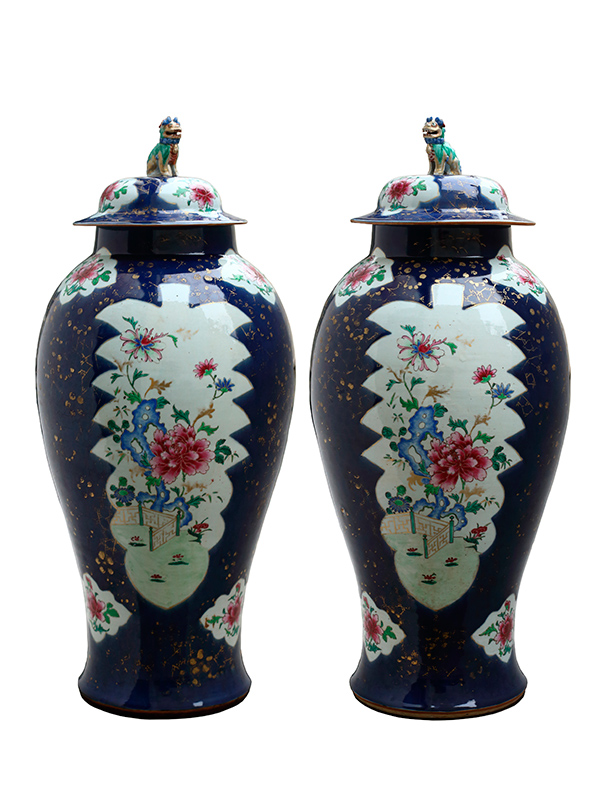 A pair of powder blue jars and covers